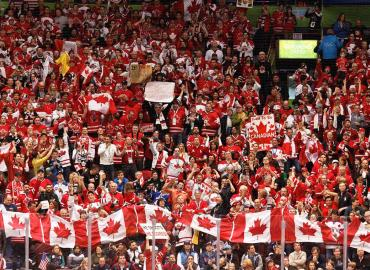 Canadian hockey fans cheering at the 2010 Winter Olympics in Vancouver