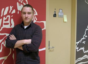 A portrait photo of Professor Ryan DeCaire, taken in the Centre for Indigenous Studies